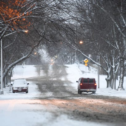 Snow and slush cover Summit Avenue in Sioux Falls on