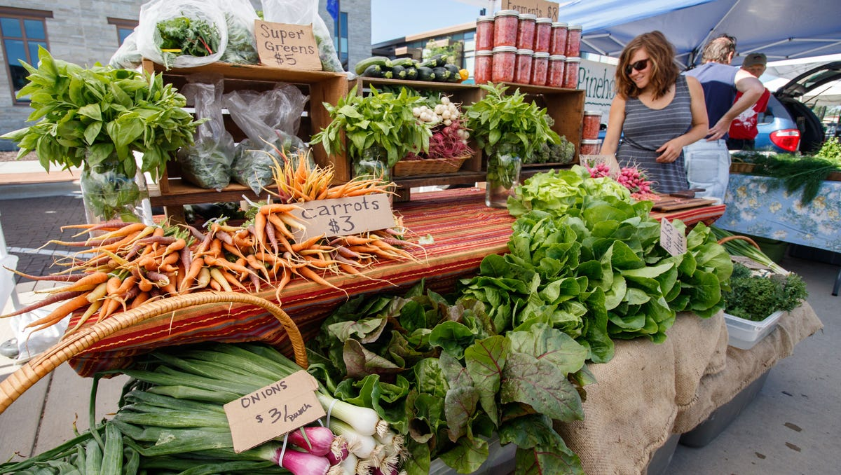 Sara Krohn of Village Farmstead LLC. in Oak Creek offers a variety of fresh produce during the Oak Creek Farmers Market at Drexel Town Square on Saturday, July 7, 2018. The market features up to 40 vendors each week, offering locally grown farm fresh foods, vine-ripened produce, fruits, cheeses, eggs, meats, honey, flowers and more.