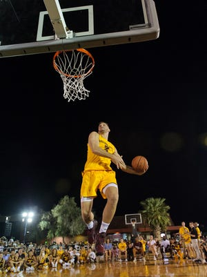ASU's Mickey Mitchell (#3) goes up for his first slam dunk of the the slam dunk contest during Mill Madness on Friday, Oct.13, 2017, at Mill Avenue & 7th St. in Tempe, Ariz.