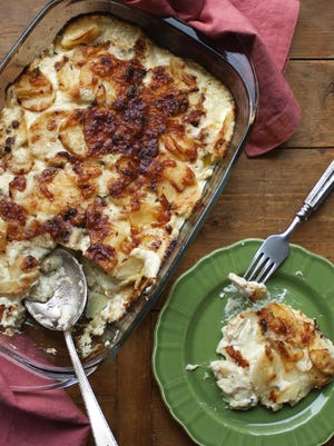 Thyme and Yukon Gold potato gratin would be lovely with roasted salmon and a peppery green salad.