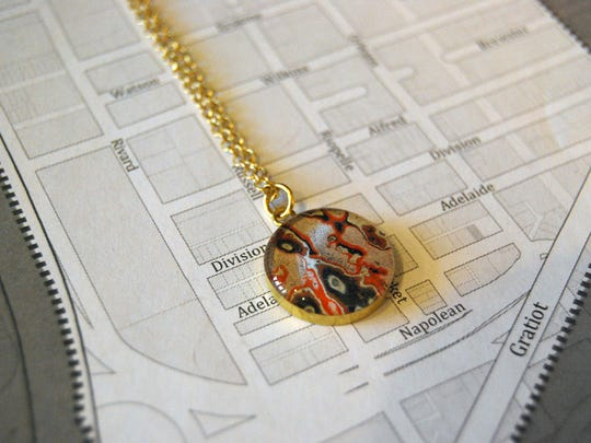 Winner of our Fresh Faces contest will receive a pendant similar to this one from Rebel Nell, a Detroit jewelry maker that turns shards of graffiti into necklaces and bracelets and more.