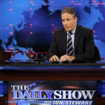 "FILE - In this Aug. 22, 2007 file photo, Jon Stewart hosts a taping of Comedy Central's ""The Daily Show With Jon Stewart"" in New York. Stewart enters the home stretch of his 16 years on Comedy Central's ""The Daily Show"" on Monday, with 12 more nights of jokes at the expense of those who make and report the news before he signs off for good on Aug. 6. (AP Photo/Jason DeCrow, file)"
