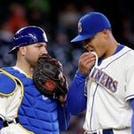 Seattle Mariners catcher Chris Iannetta, left, and starting pitcher Taijuan Walker talk after Walker gave up two home runs to the Minnesota Twins in the fourth inning of a baseball game, Sunday, May 29, 2016, in Seattle. (AP Photo/Elaine Thompson)