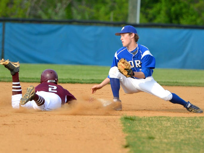 Stuarts Draft's Adam Carter dives safely back into second base before Fort Defiance's Bryce Harlow can make the tag during a pickoff attempt during the second inning of their baseball game played in Fort Defiance on May, 14, 2014.