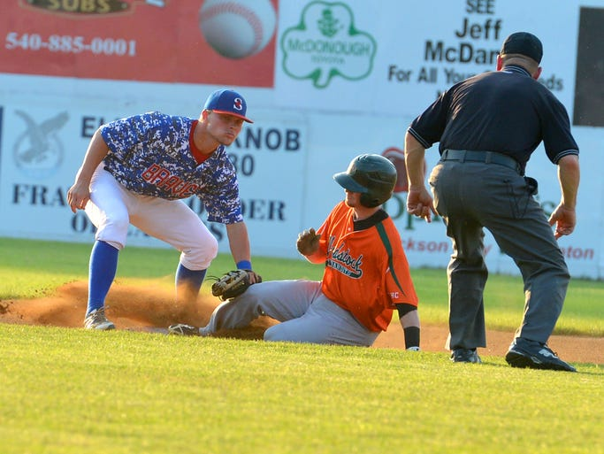 Staunton Braves' Jimmy Redovian tags Woodstock River Bandits' Andrew Brodbeck at second base in the first inning of a Valley League Baseball game played in Staunton on Monday, June 16, 2014.