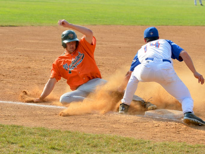 Woodstock River Bandits' Zach Jarrett tries to steal third base but is tagged out by Staunton Braves' Derek Gallello in the seventh inning during a  Valley Baseball League game played in Staunton on Friday, July 11, 2014.