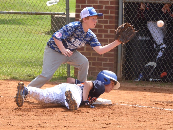 Staunton's Garret Lowler dives safely back to first base as Halifax County South's Joey Duffer catches the throw in a pickoff attempt at first base in the fourth inning in a game during the first round of pool play in the Babe Ruth Cal Ripken Southeast Regional for 12 Year-olds in Gypsy Hill Park on Wednesday July 16, 2014.