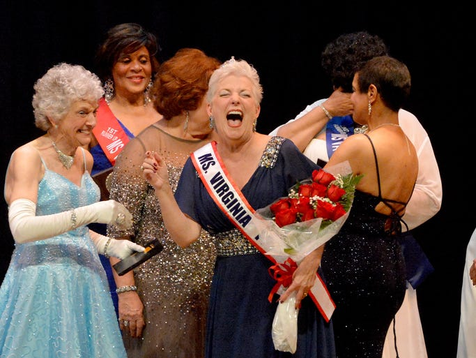 Patsy Godley shows her excitement after being crowned Ms. Virginia Senior America 2014 during a pageant held in Healy Auditorium at the Virginia School for the Deaf and the Blind on Saturday, July 19, 2014.
