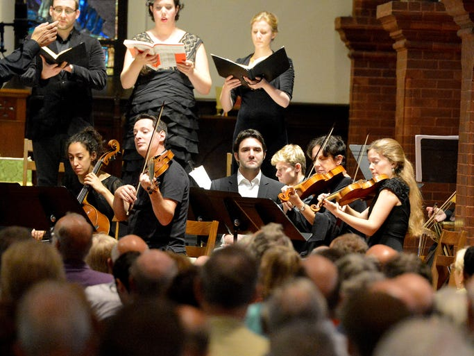 """Musicians perform """"The Passion According to St. Matthew, BWV 244"""" by Johann Sebastian Bach for those gathered at Trinity Episcopal Church for the final concert in this year's Staunton Music Festival on Sunday, August 24, 2014."""