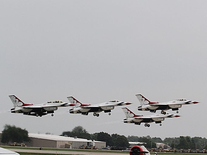 The USAF Thuderbirds take to the sky at the 2014 EAA Airventure in Oshkosh on Friday.