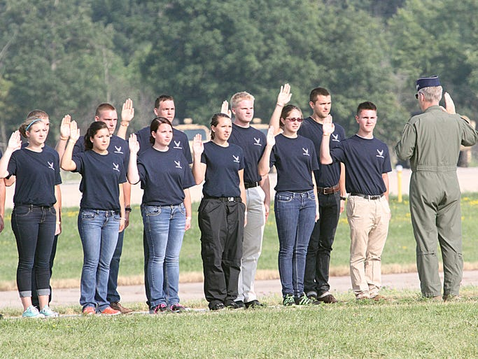 Prior to the United States Air Force Thunderbirds show the oath of enlistment was taken by a group of young adults committing themselves to the military service at the 2014 EAA Airventure.