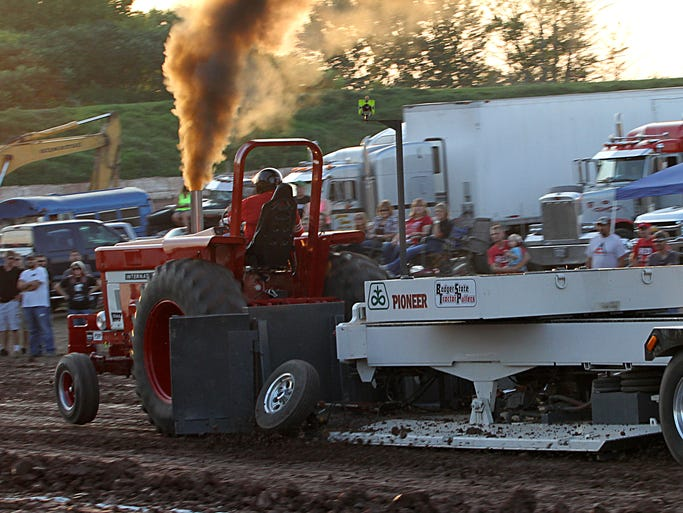 The Winnebago County Fair grandstand was the site for the Badger State Tractor Pull on Friday. Trucks and tractors from all over competed in the day's highlight attraction.
