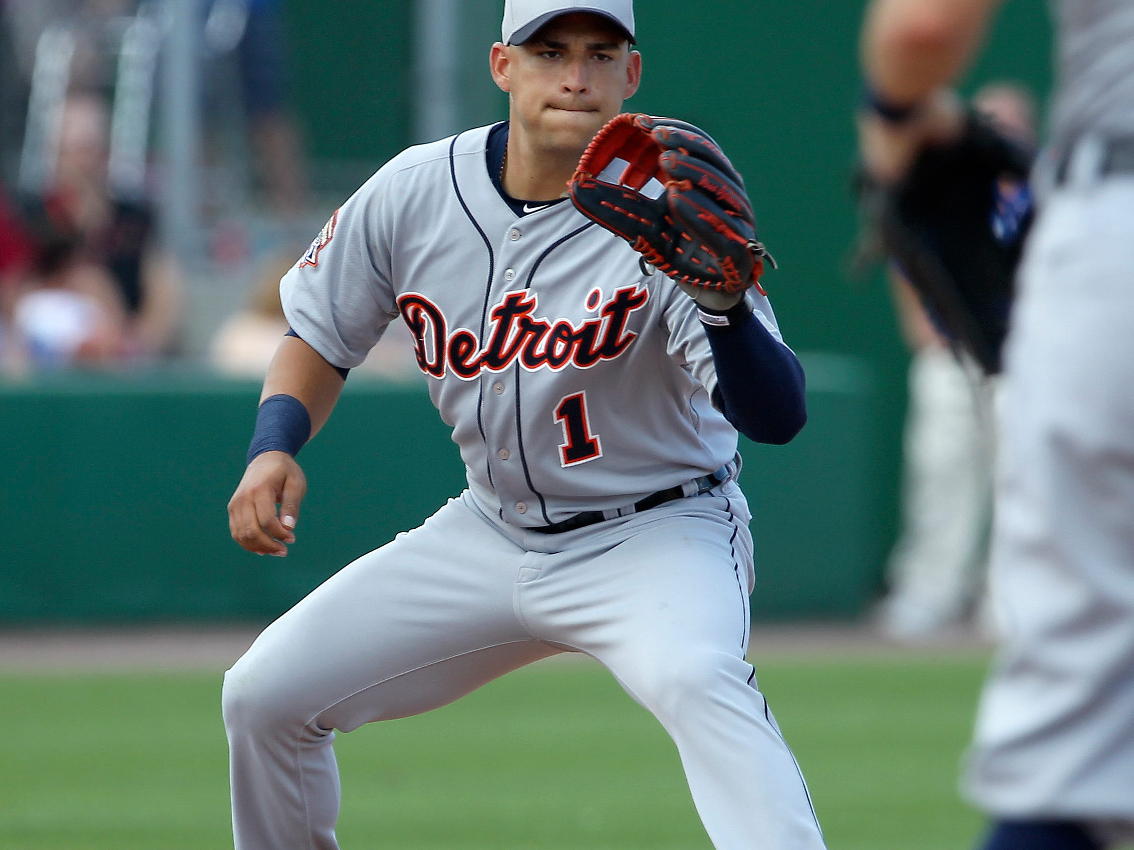 Tigers shortstop Jose Iglesias (1) waits for the throw from second baseman Ian Kinsler (not pictured) to force out Philadelphia Phillies left fielder Domonic Brown (not pictured) during the fourth inning of a spring training baseball game at Bright House Field.
