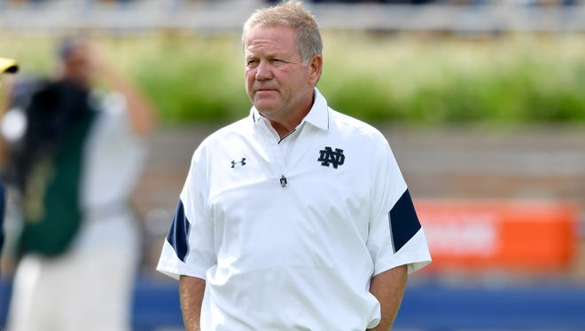 Sep 10, 2016; South Bend, IN, USA; Notre Dame Fighting Irish head coach Brian Kelly watches warmups before the game against the Nevada Wolf Pack at Notre Dame Stadium. Mandatory Credit: Matt Cashore-USA TODAY Sports