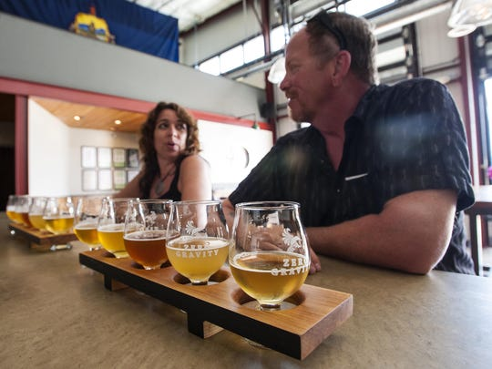 Judie and Mark O'Donnell of Danbury, Connecticut, enjoy a flight of beer at the Zero Gravity tasting room in Burlington in 2015.