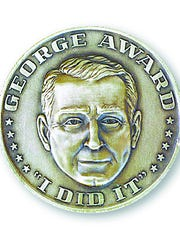 George Award medallion given to recipients of the Enquirer's annual community service award.