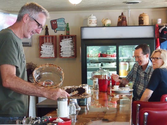 Country Boy owner Tom Fanning slices one of the restaurant's