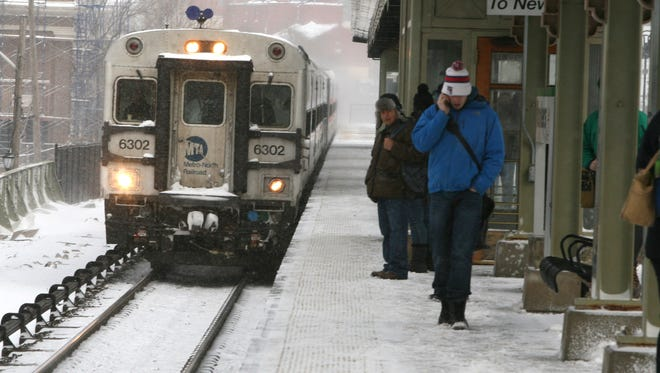 A train to New York City arrives at the Metro-North Yonkers station. Experts say that all crashes are different and that one car isn't necessarily safer or more dangerous than another.