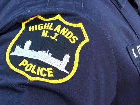 A Highlands Police patch is shown on Patrolman Kevin