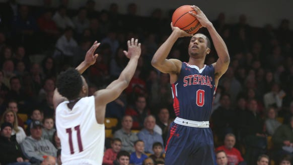 Stepinac's Alan Griffin takes a shot over Iona Prep's Romar Reid during a game at Iona College's Hynes Center Feb. 3, 2018.