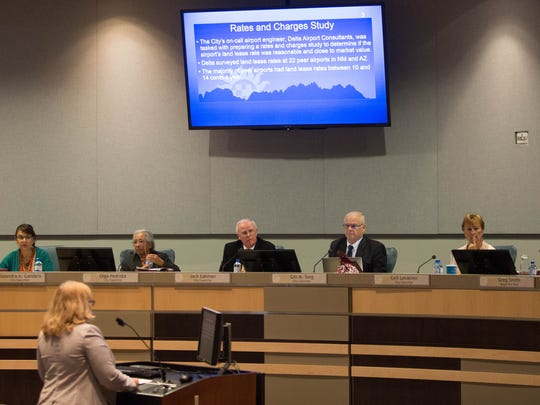 Lisa Murphy, the Las Cruces International Airport manager, gives a presentation to the city council about a resolution amending the land lease rate at the Las Cruces International Airport. Monday October 16, 2017.