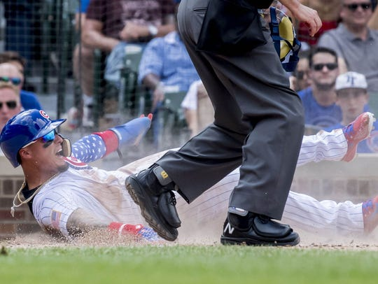 Thirty yards and a cloud of dust - Cubs infielder Javy