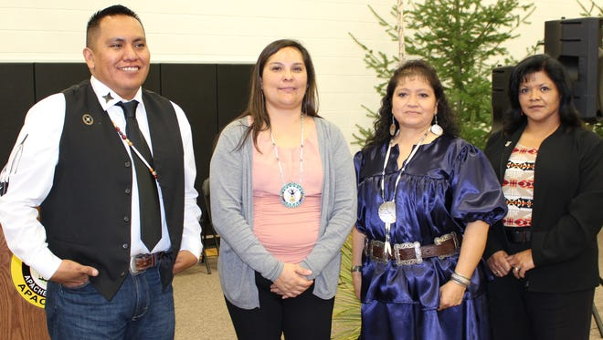 Smiling together Jan. 13 after taking their oaths of office are the newest members of the Mescalero Apache Tribal Council elected last November. From left are Pascal Enjady, Leclaire Gayton, Pamela Morgan, Miralene Blaylock