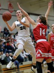 Appleton North High School's Sydney Levy (24) drives to the basket against Kimberly High School's Taylor Hietpas (14) during their girls basketball game Friday, December 1, 2017, in Appleton, Wis. 