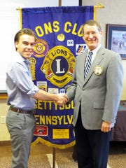 Gettysburg Lions Club President Bob Teeter, right,
