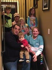 Rodney and Lisa Thrash with their grandchildren.