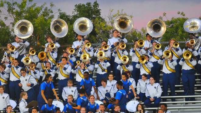The Titusville High band would like to replace its nearly 20-year-old uniforms, but the cost would be around $100,000.