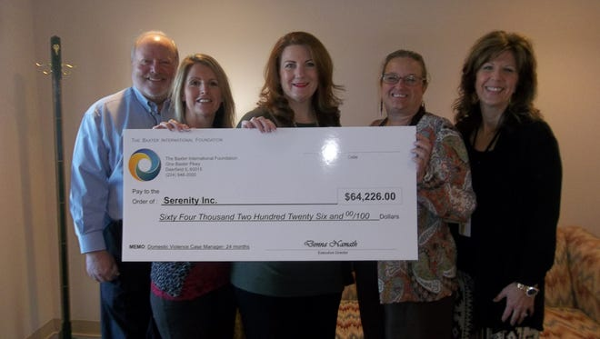 Shown with the $64,000 Baxter International Foundation grant to Serenity, Inc. are: (from left) Glenn Burney, Baxter Healthcare plant manager; Lacey Johnson, Baxter Healthcare human resource director; Kelly Lucas, Baxter Healthcare human resource manager; Niki de Soto, Serenity, Inc. executive director; and Donna Forrester, Serenity, Inc. shelter manager.
