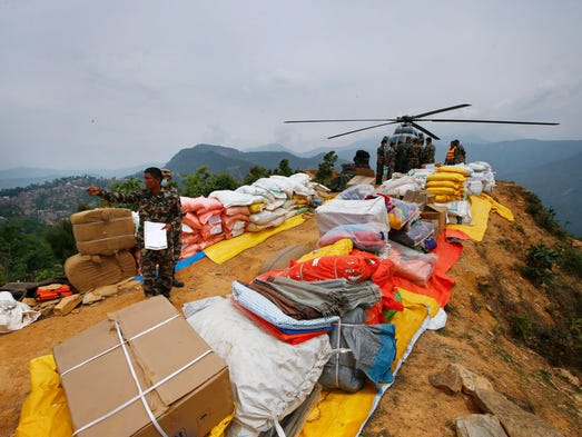 Nepalese soldiers coordinate  supply relief material