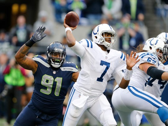 FILE - In this Sunday, Oct. 1, 2017 file photo, Indianapolis Colts quarterback Jacoby Brissett (7) passes under pressure from Seattle Seahawks defensive tackle Sheldon Richardson (91) in the first half of an NFL football game in Seattle. Jacoby Brissett understands Sunday, Oct. 8, 2017 will be Peyton Manning's show. The newest Indianapolis Colts quarterback just wants to honor the old one properly with a winning performance against San Francisco. (AP Photo/Stephen Brashear, File)