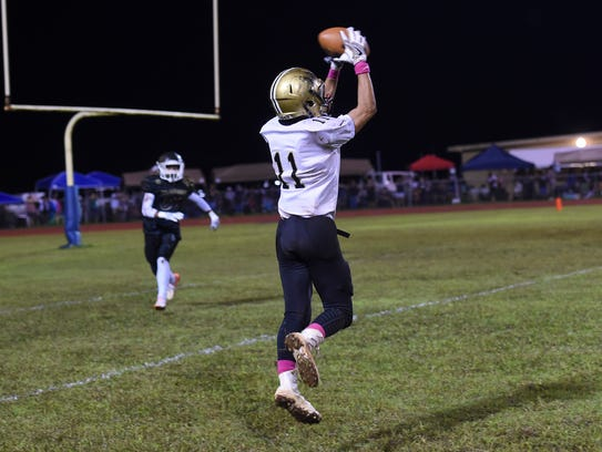 Tiyan High's Andrew Blas (11) makes a catch against