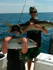 Chuck and James Stout caught their amberjacks in 110 feet of water off Sanibel Saturday on a family fishing trip with their dad, David, of North Fort Myers.