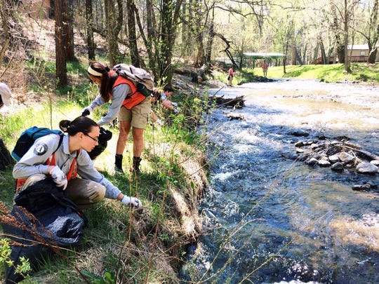 One of the photographs sent to the competition marking the Keep Ruidoso Beautiful event showed participants cleaning up along the river.