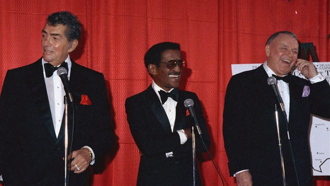 """Show biz legends Frank Sinatra, right, Sammy Davis, Jr., and Dan Martin, left, members of the """"rat pack"""" in the 1960's, break out in laughter Dec. 1, 1987, during an appearance at Chasen's restaurant in Beverly Hills, Calif., at which they announced plans for an upcoming 40 performance, 29 city North American tour in 1988. (AP Photo/Kim Carlsberg)"""