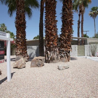 This mid-century modern homes is for sale on N. Via