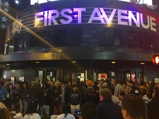 Crowds gather outside the Minneapolis club First Avenue, famed for helping launch Prince's career. Throngs arrived to pay their respects to Prince and remember him  through his music.