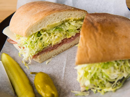 The Steamboat signature sandwich at Steamboat Sandwiches in Knoxville on Friday, April 6, 2018. The Steamboat contains smoked ham, Genoa salami, exciter sauce, Swiss cheese, mayo, mustard, pickles and lettuce.