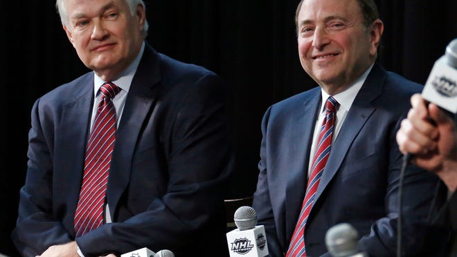 FILE - In this Jan. 24, 2015, file photo, NHL Player's Association executive director Donald Fehr, left, and NHL Commissioner Gary Bettman attend a news conference at Nationwide Arena in Columbus, Ohio. Given the gravity of the pandemic and the abrupt decision to place the NHL season on pause in March, it did not take Bettman and Fehr long to realize they were going to have to work together if play was to resume any time soon.