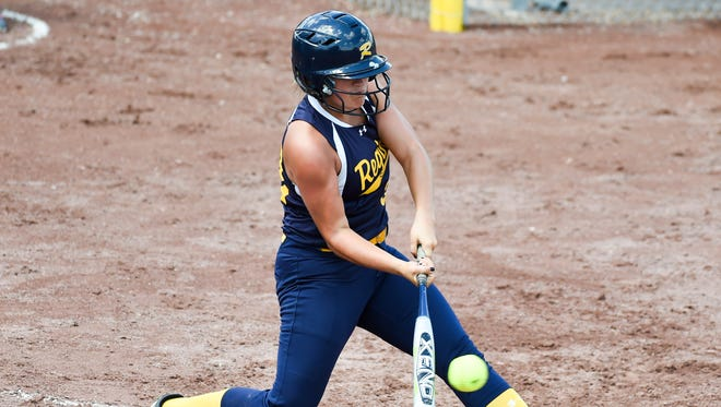 Iowa City Regina's Jenny Wick (33) gets a hit in a game against CPU on Thursday, July 23, 2015, during the Class 2-A Semifinals.