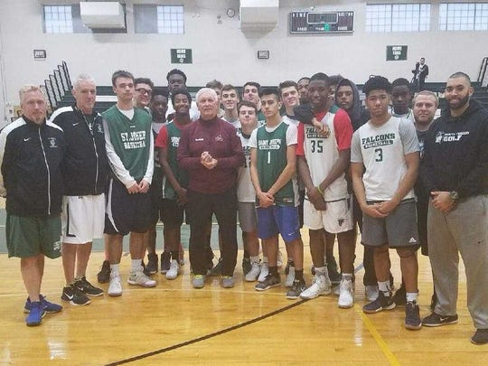 Bob Hurley (center in maroon sweat jacket) poses with the St. Joseph team during a mid-December practice.