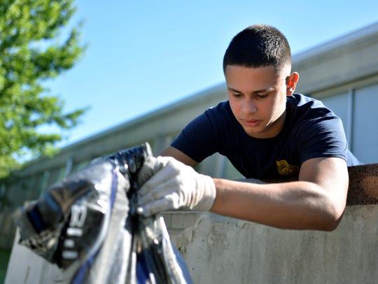 Vineland Police Explorer Joseph Torres, 17, adds new