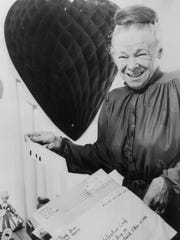 "Loveland's original ""Valentine Lady,"" Doris Pfiester, smiles heartily in this Enquirer file photo."