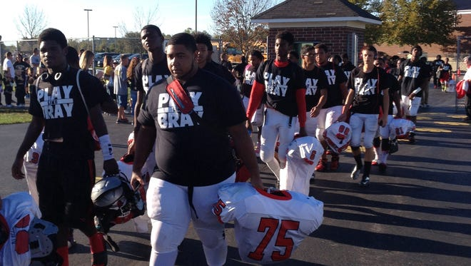 The Mount Healthy High School football team arrives for its game against Little Miami last fall wearing Play Like Bray shirts.