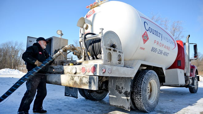 Jerry Petasek refills his propane delivery truck at the Country Visions Cooperative facility in the town of Lawrence.