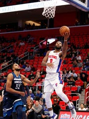 Pistons center Andre Drummond (0) goes up for a shot against Timberwolves center Karl-Anthony Towns (32) during the fourth quarter of the Pistons' 122-101 win over the Timberwolves on Wednesday, Oct. 25,2017, at Little Caesars Arena.