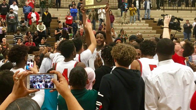 Highland Park celebrates its Class 5A boys basketball sub-state championship after a victory over Aquinas on March 6 at Hi Park. The Scots were approved Tuesday as a new member of the Kansas City Atchison League, effective for the 2022-23 school year.